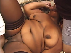 Fat black chick gets two dicks stuffed in her sex holes